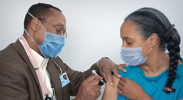 Doctor Administering Vaccine